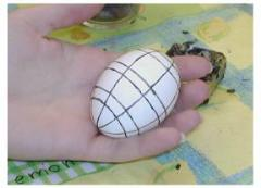 Pysanky: wax lines have been drawn on the white egg, which is ready to go in to the first dye.  Anything covered in wax at this stage will remain white